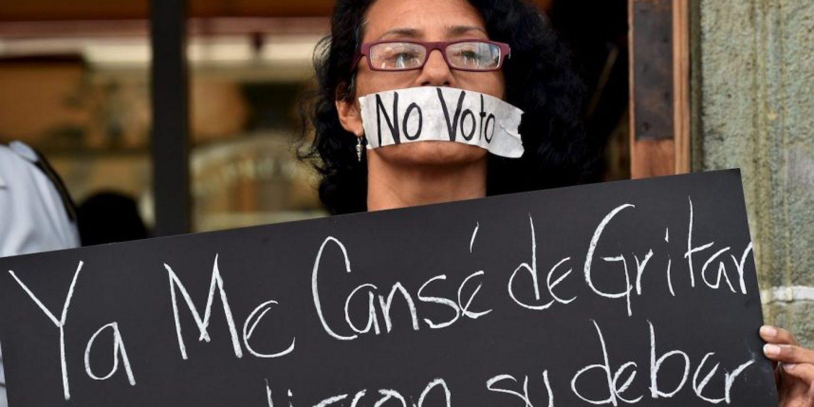Mientras tanto, esto fue lo que los manifestantes acusaban Foto:AFP