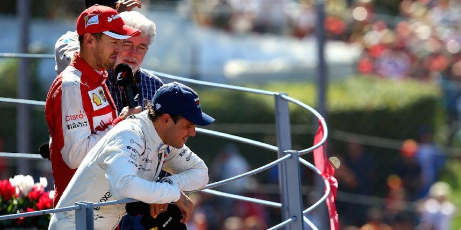 George conversando con Sebastian Vettel. Foto:Getty Images