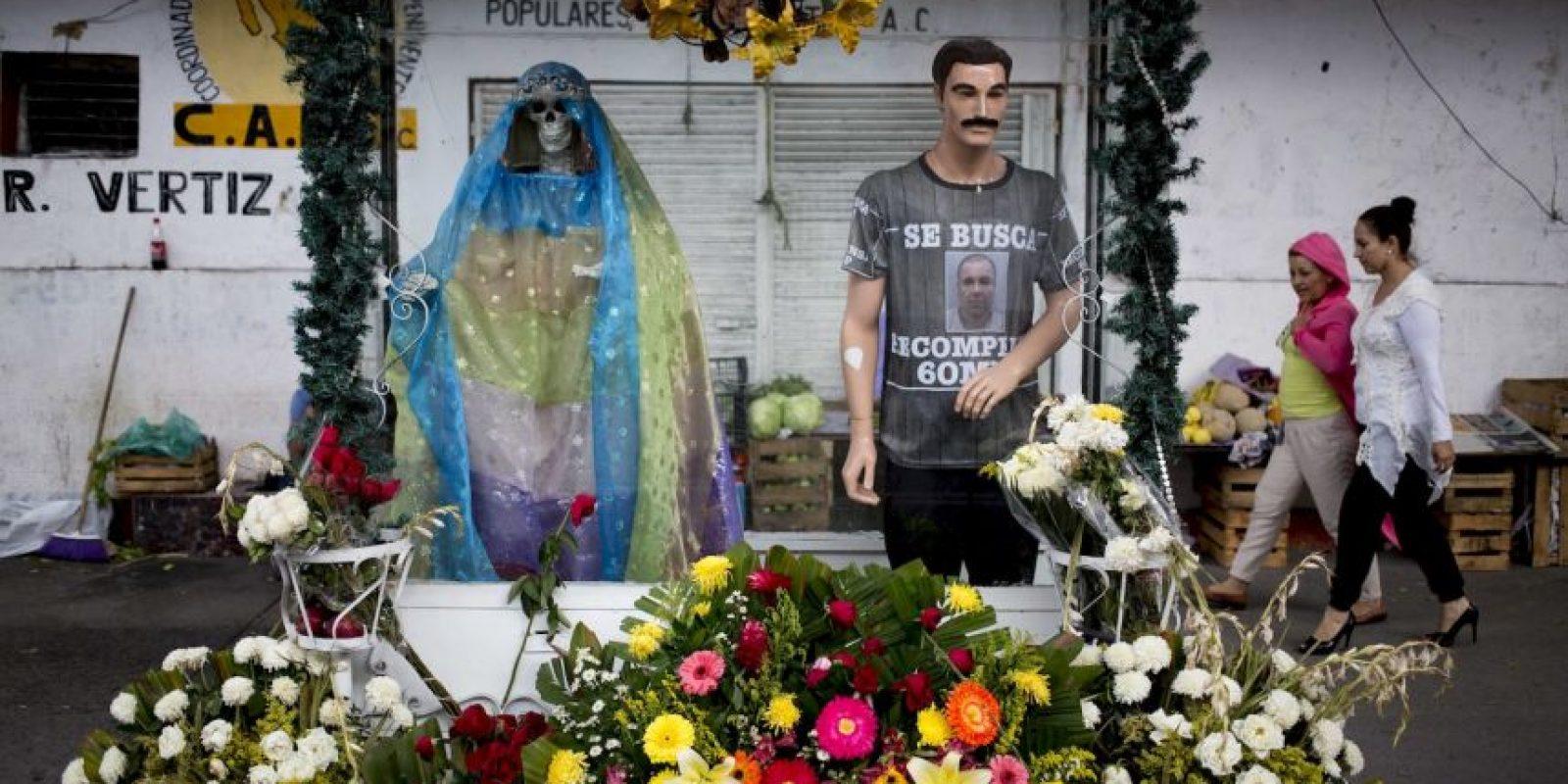 """Junto a personajes como """"Jesús Malverde"""" o """"La Santa Muerte"""" Foto:AP"""