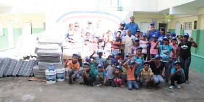 Licey y jugadores llevan aporte a orfanato