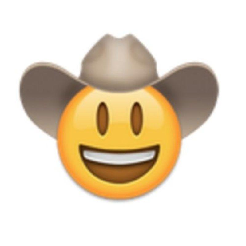 Cara sonriente con sombrero. Foto:vía emojipedia.org