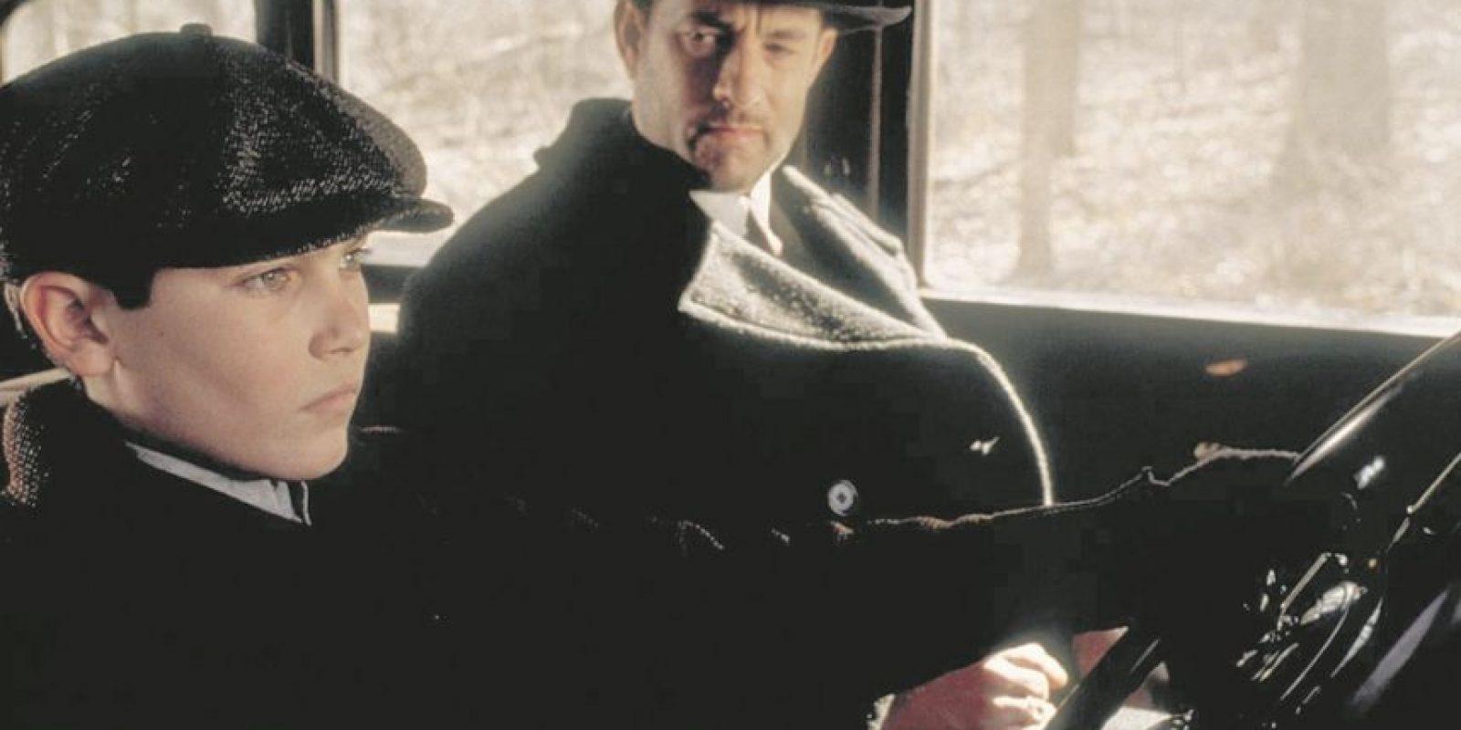 """7- Michael Sullivan – Camino a la perdición. De Sleepless In Seattle a The Polar Express, Tom Hanks es la figura paterna ideal. En esta cinta de gánsteres durante la época de la depresión, Michael Sullivan (Hanks), quien trabaja para la mafia, hace cualquier cosa para proteger a su hijo Michael de sus empleadores –incluso matar a su propia figura paterna–. """"Me da gusto que seas tú"""", dice el viejo en una escena conmovedora. En una misión de venganza, Sullivan introduce al chico al mundo del crimen, pero espera que elija un camino distinto, y eventualmente lo hace. Foto:Fuente externa"""