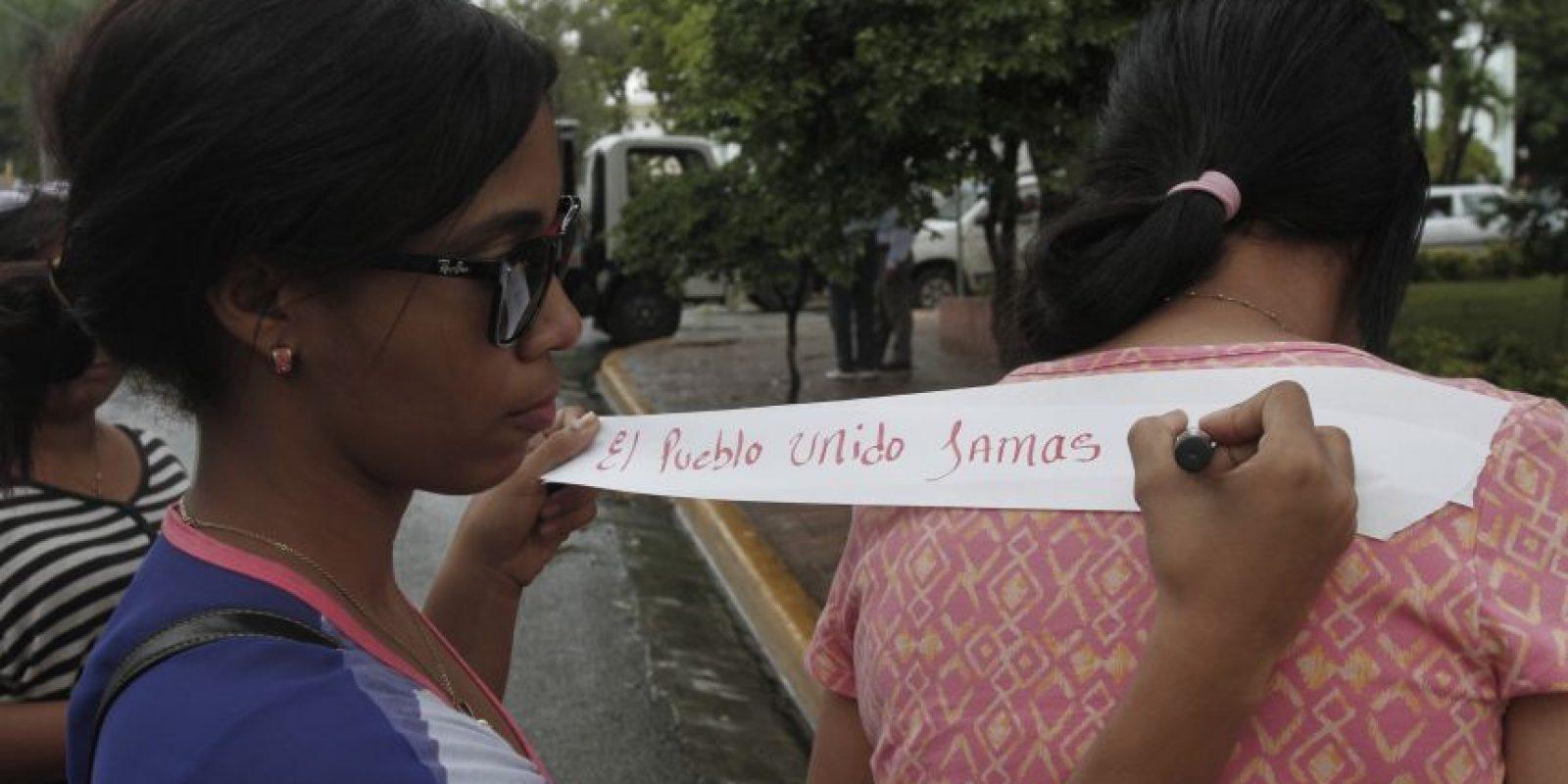 """Cántico.""""El sistema está podrido por los jueces corrompidos. A los jueces de Mariano, los mandamos pa´ Najayo"""". Foto:Roberto Guzmán"""