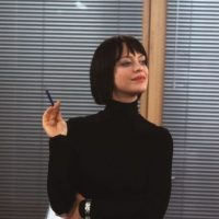 Heike Makatsch interpretó a la secretaría de Rickman. Foto:Universal Pictures