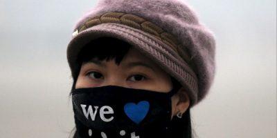De moda, estos son los cubrebocas que utilizan contra el esmog en Beijing, China Foto:AP