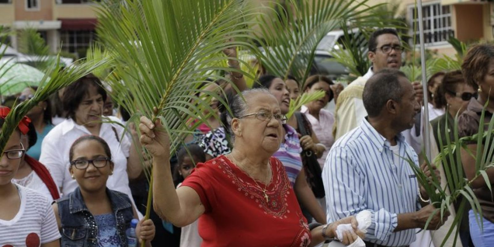 La procesión con ramos es parte de la liturgia de este día Foto: Roberto Guzmán