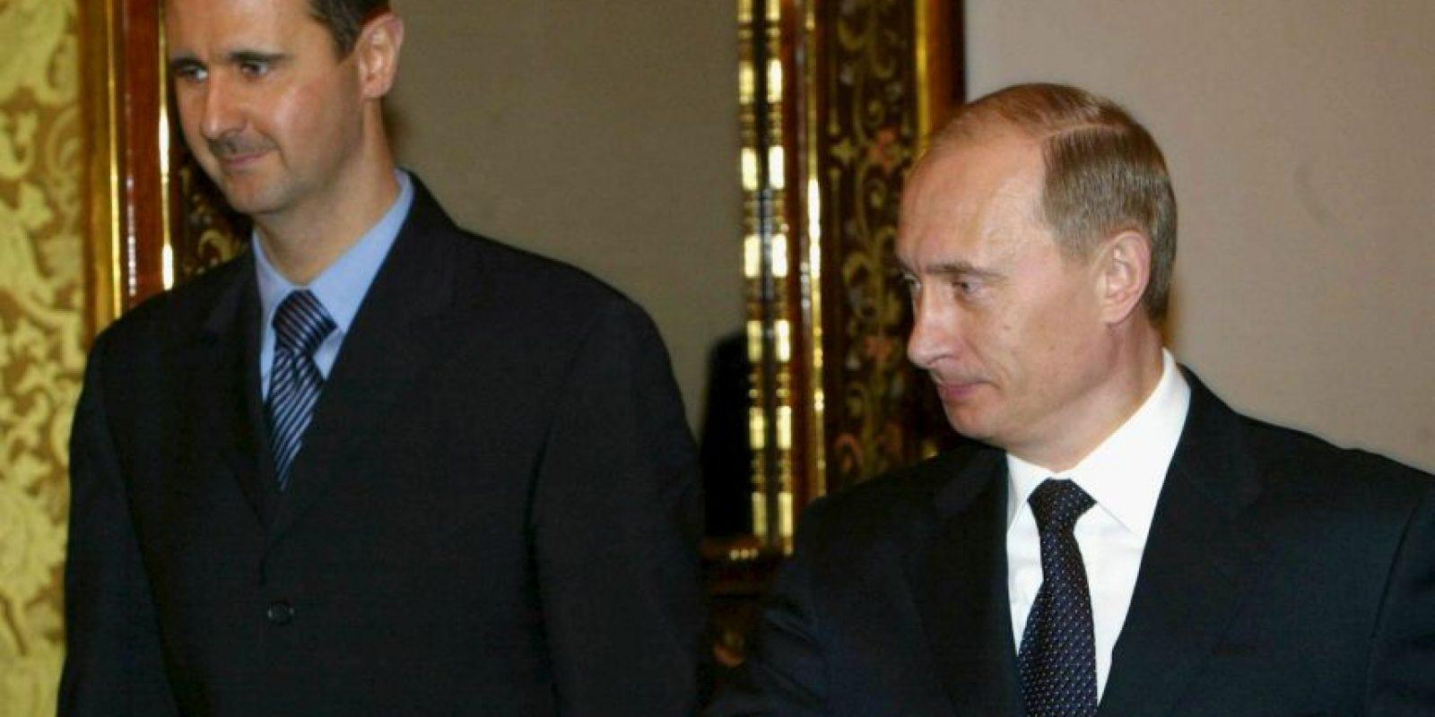 Y con el presidente Vladimir Putin en 2005; uno de sus más fuertes aliados hasta el momento Foto:Getty Images