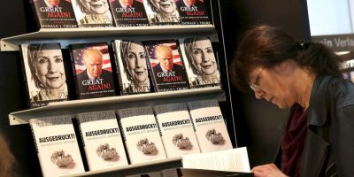 FRANKFURT AM MAIN, GERMANY – OCTOBER 22: Books about Donald Trump and Hilary Clinton are displayed on the Plassen stand at the 2016 Frankfurt Book Fair (Frankfurter Buchmesse) on October 22, 2016 in Frankfurt am Main, Germany. The 2016 fair, which is among the world's largest book fairs, will be open to the public from October 19-23. (Photo by Hannelore Foerster/Getty Images)