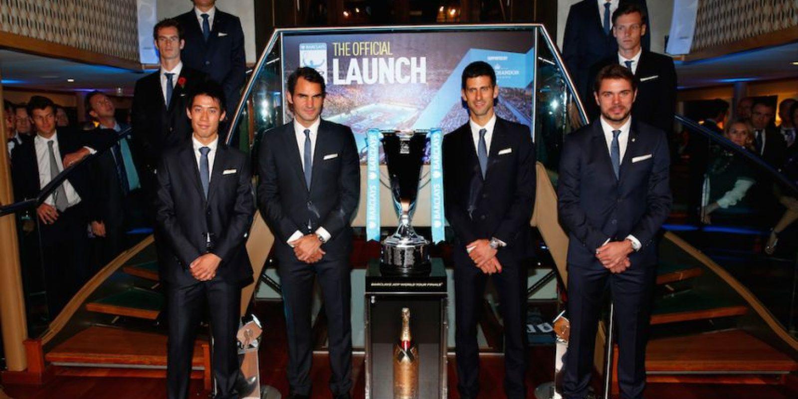 Los tenistas junto al trofeo. Foto:Getty Images