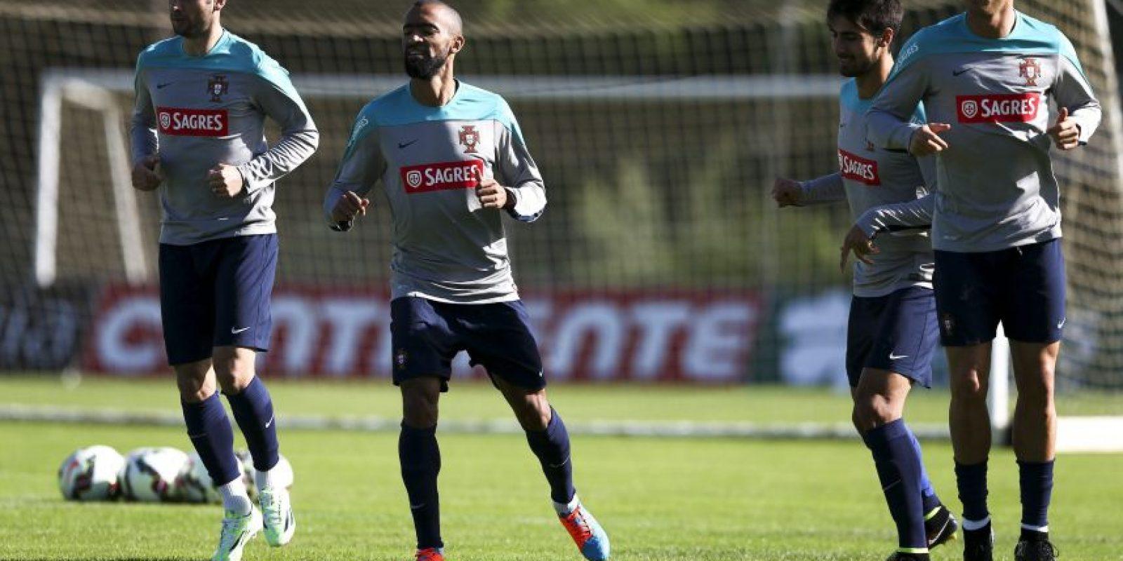 Los jugadores Helder Postiga (i), José Bosingwa (2-i), Andre Gomes (2-d) y Cristiano Ronaldo, en el entrenamiento. Foto:AFP