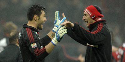 Amelia y Abbiati celebran durante un partido de la Serie A. Foto:Getty Images