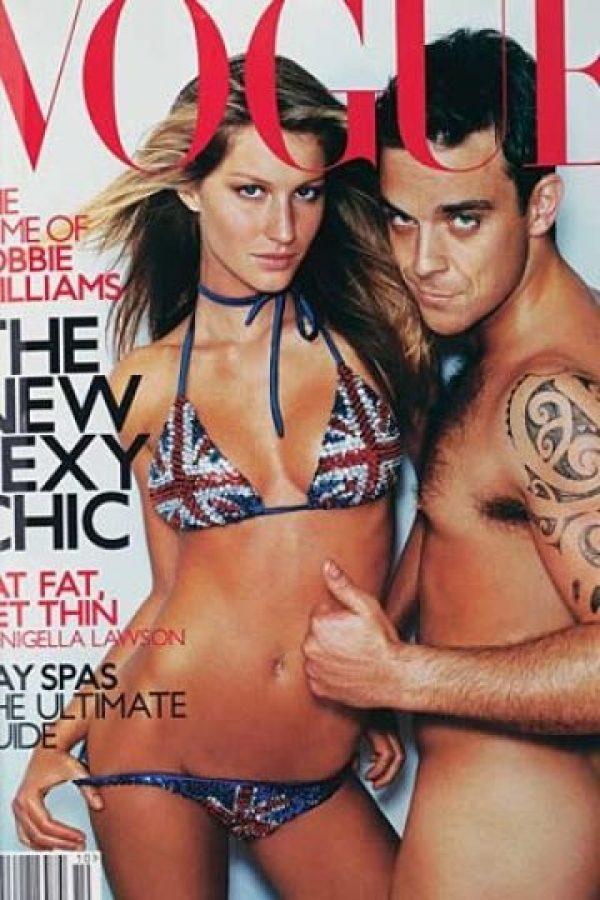 """Gisele Bundchen y Robbie Williams en 2000. La portada fue criticada por """"indecente"""" Foto:Vogue"""