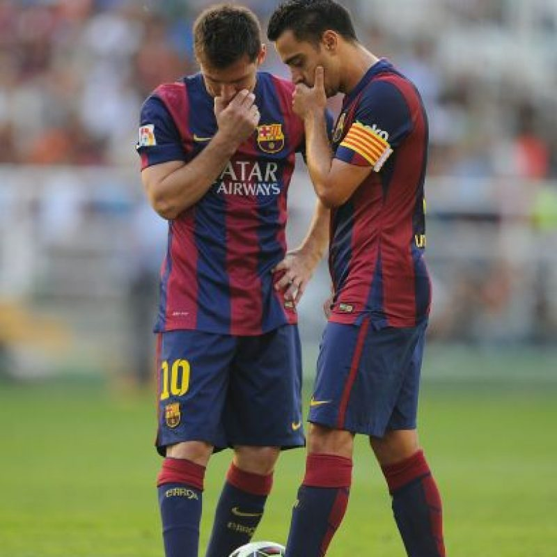 Messi junto a Xavi Hernández. Foto: Getty Images