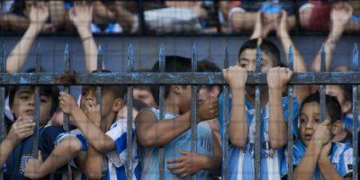 Estos pequeños esperaban con ansías el gol de la victoria. Foto:AFP