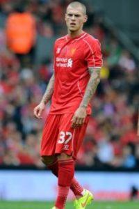 El defensa eslovaco del Liverpool tiene tatuajes en los bra zos y el dorso. Foto:Getty Images