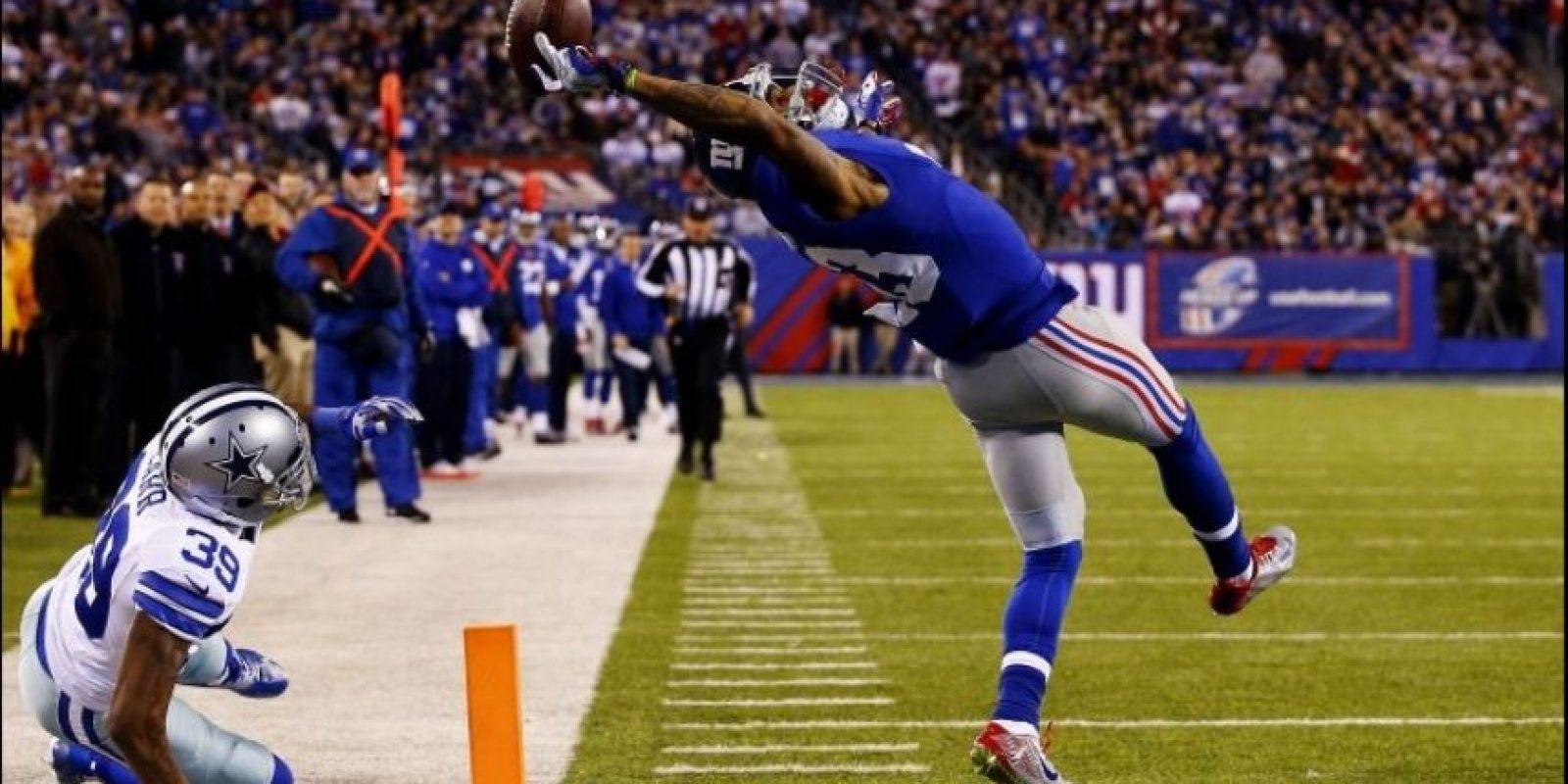 """Segundo lugar """"Deportes"""": Al Bello, de Estados Unidos, captó la atrapada que realizó Odell Beckham en el partido entre los Gigantes de Nueva York y los Vaqueros de Dallas Foto:World Press Photo 2015"""