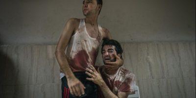 """Tercer lugar, categoría """"Historia en Noticias Generales"""": La imagen captada por Sergey Ponomarev de Rusia muestra a dos hermanos en el conflicto en la Franja de Gaza Foto:World Press Photo 2015"""