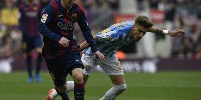 Messi tuvo pocos buenos momentos, como aquí superando a Samuel Castillejo. Foto:AFP