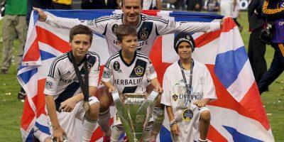 David celebrando su triunfo junto a sus hijos. Foto:Getty