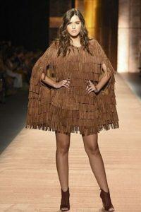 No todo son vestidos fastuosos para Paulina Vega. Foto:vía AFP