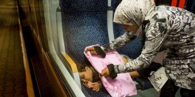 Migrantes en tren de Austria. Foto:AFP