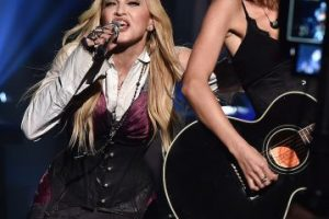 Taylor con Madonna Foto:Getty Images