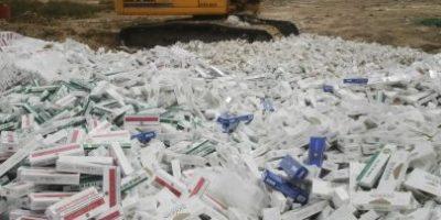 Fotos. Destruyen millones de cigarros y cientos de botellas licor de contrabando