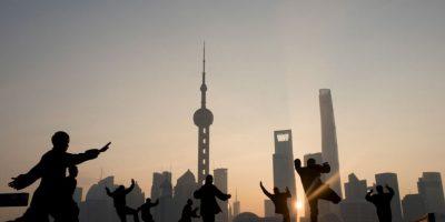 Personas ejercitándose en China. Foto:AFP