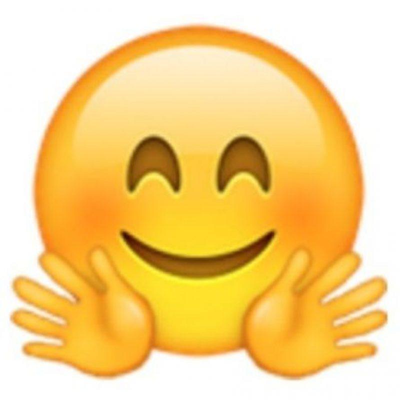 Cara sonrojada con ojos cerrados y manos abiertas. Foto:vía emojipedia.org