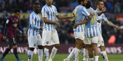 Jugadores del Málaga celebran un gol.