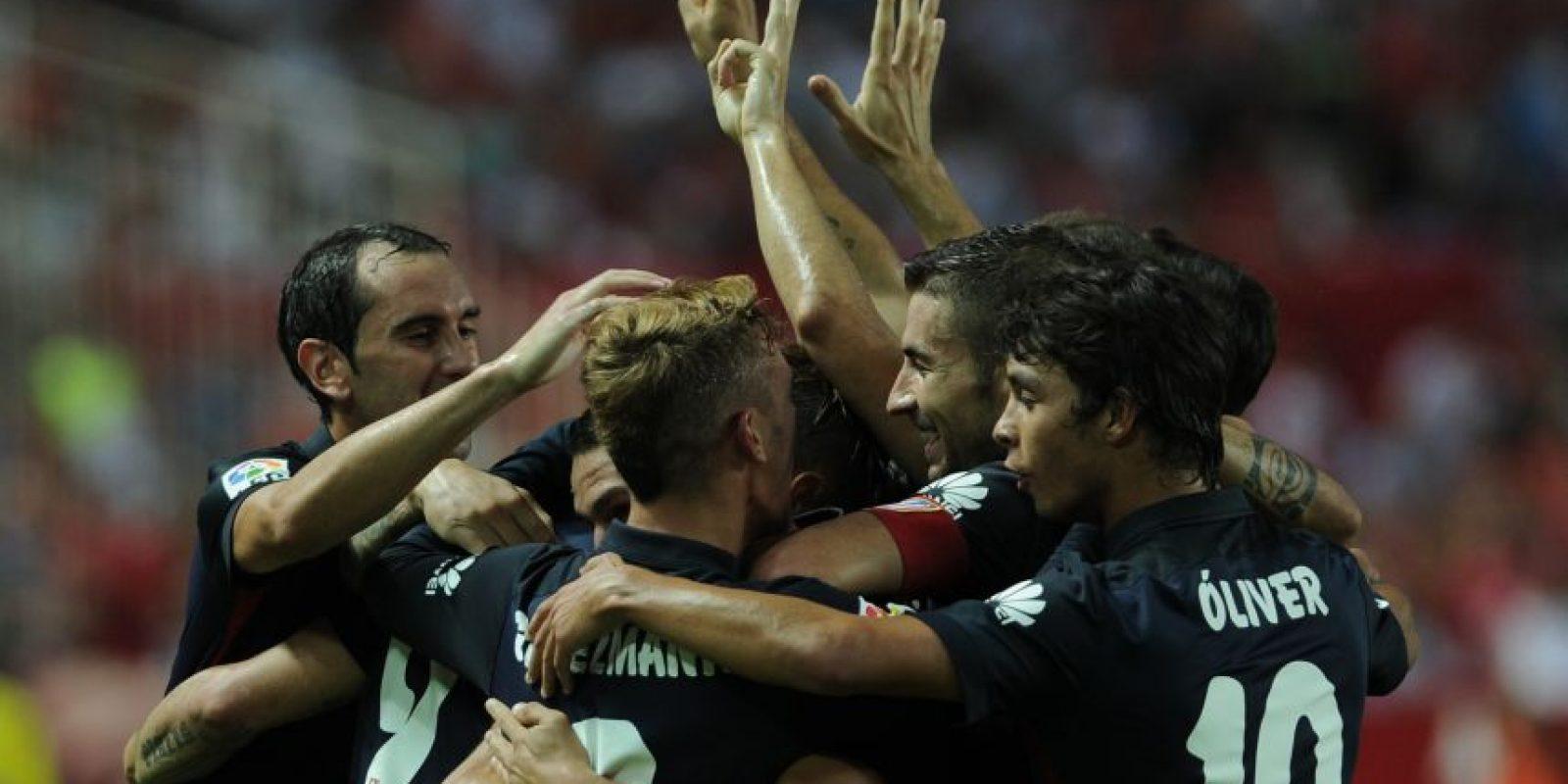 Los jugadores colchoneros celebran un gol. Foto:AFP