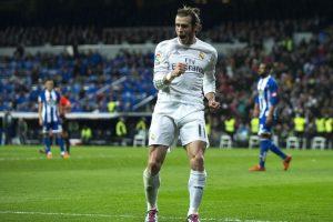 El jugador galés festeja un tanto en la liga. Foto:AFP