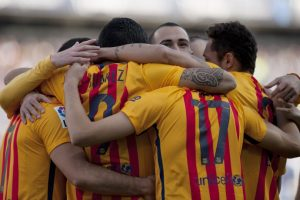 Jugadores del FC Barcelona celebran su anotación ante el Málaga. Foto:AFP