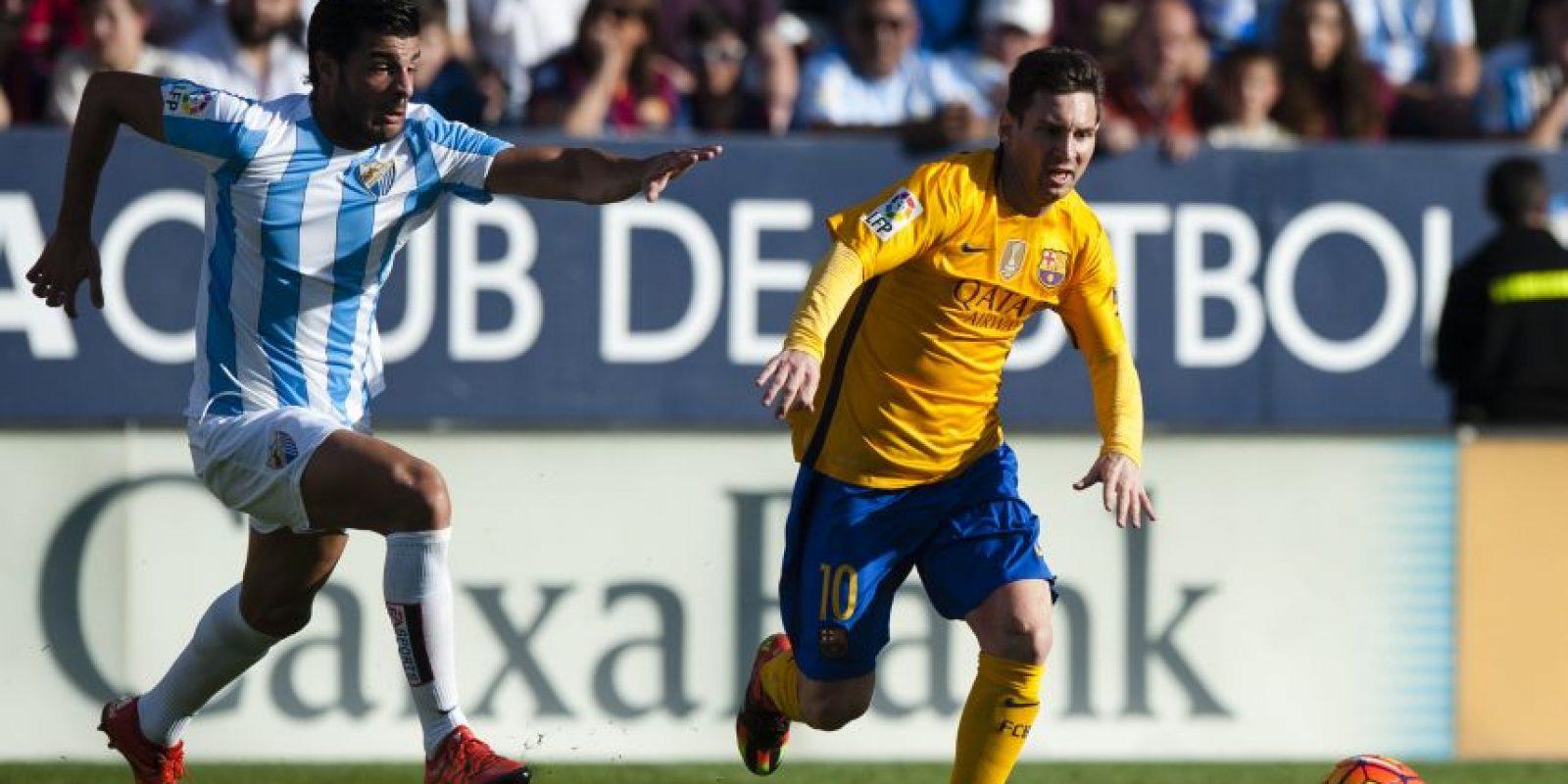 Acción del partido entre Málaga y FC Barcelona. Foto:AP