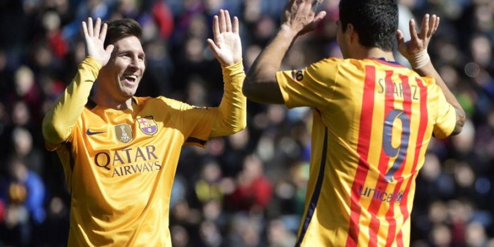 Lionel Messi y Luis Suárez celebrando un gol con el Barcelona. Foto:AFP