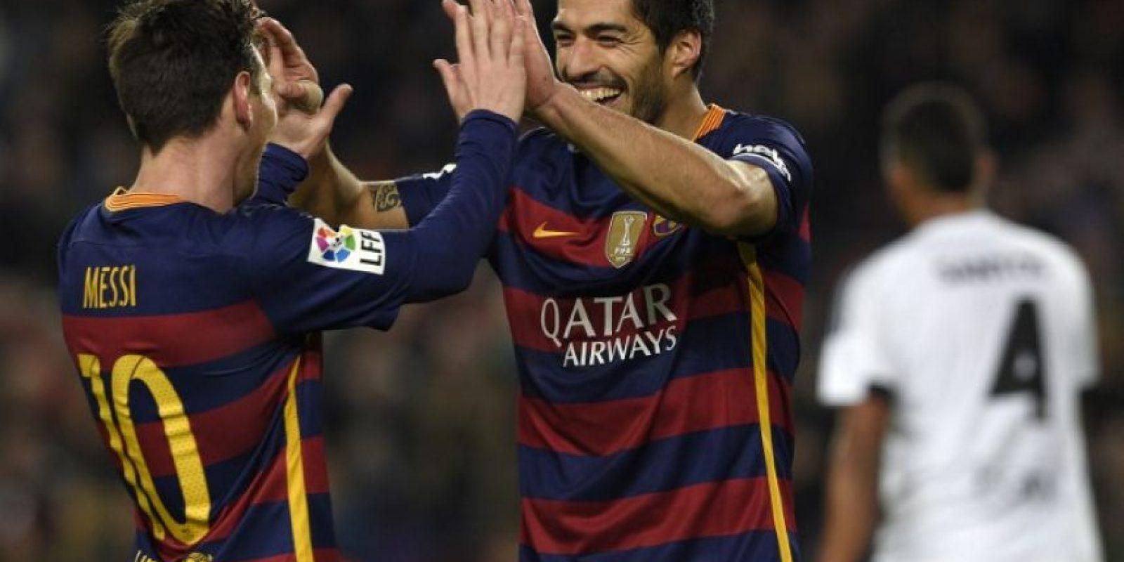 Lionel Messi y Luis Suárez celebrando un gol. Foto:AFP
