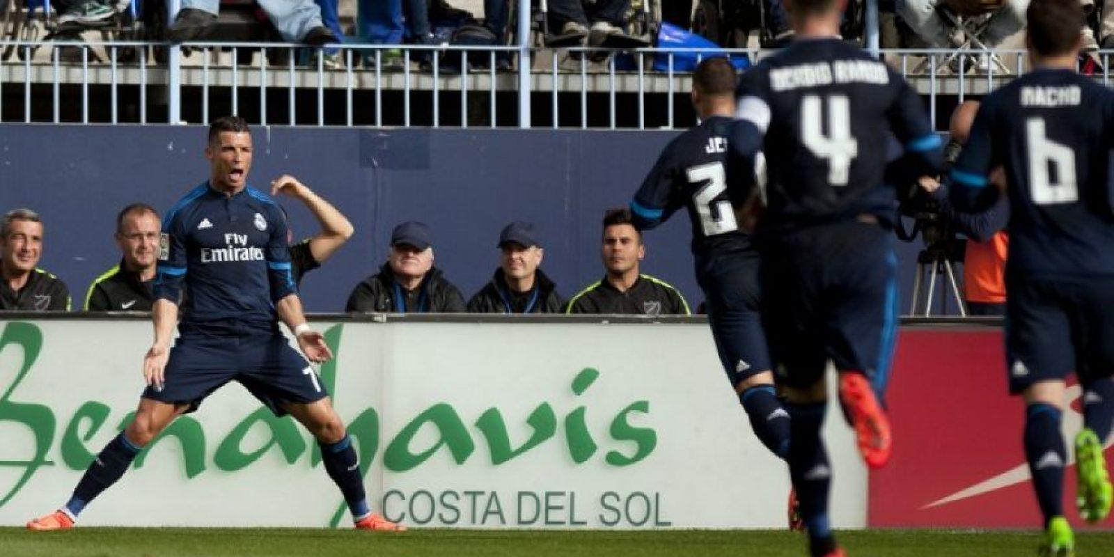 Cristiano Ronaldo celebra un gol contra el Málaga en La Liga. Foto:AFP