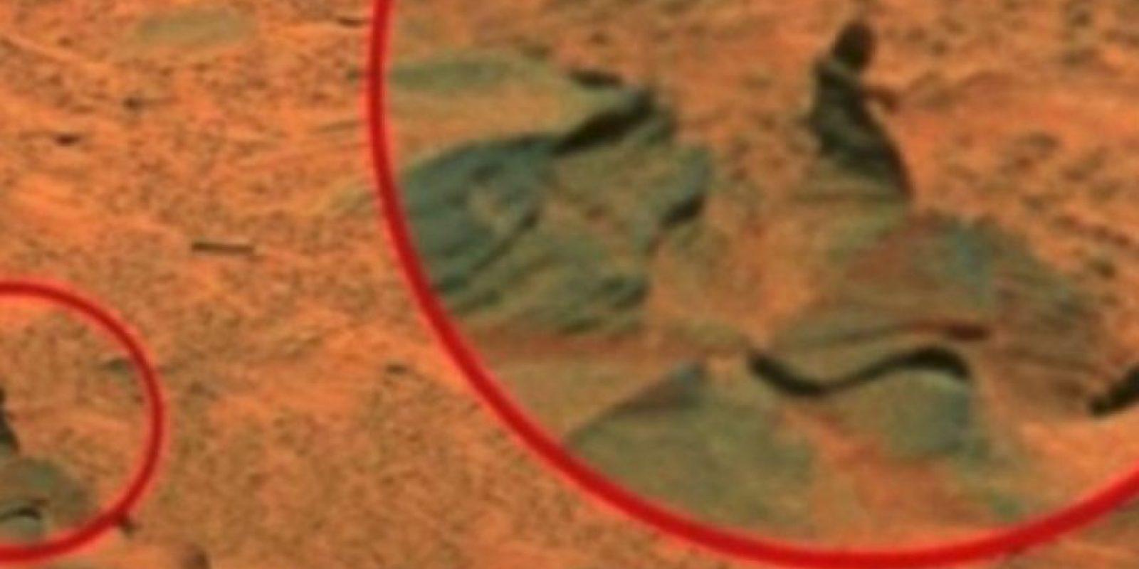 Una mujer sentada en una roca Foto:NASA