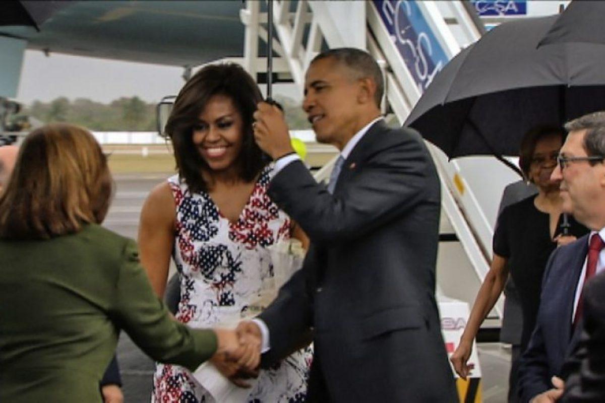Acompañado de su esposa Michelle, y sus hijas Sasha y Malia, Barack Obama llegó en el avión presidencial Air Force One Foto:AFP