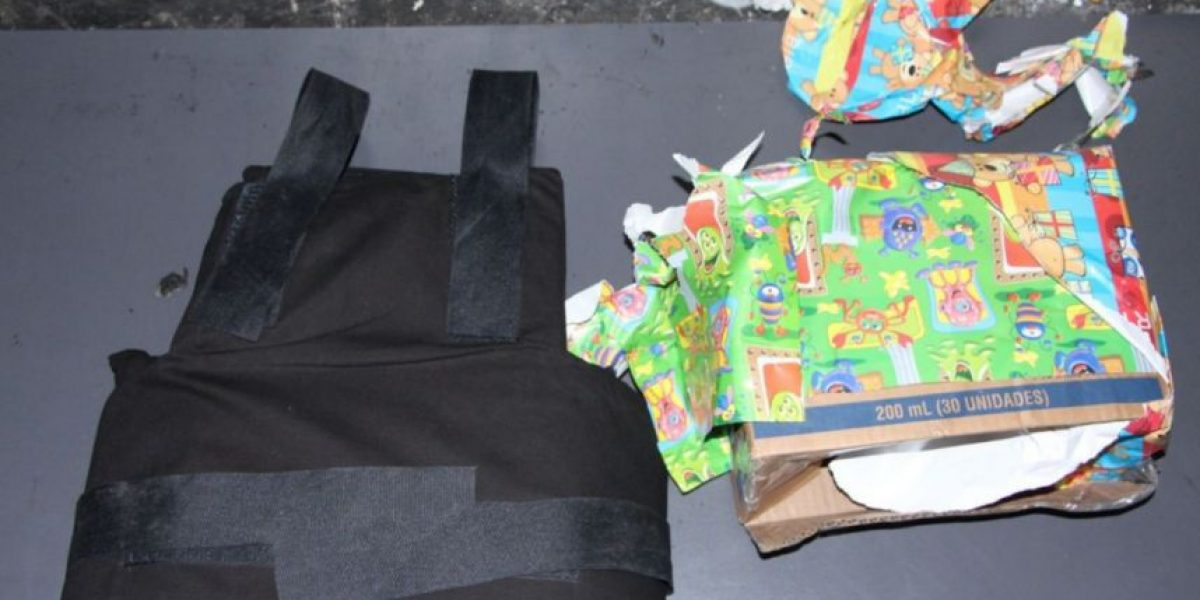 Pandilleros escondían pistola en caja de regalo, también llevaban chalecos blindados