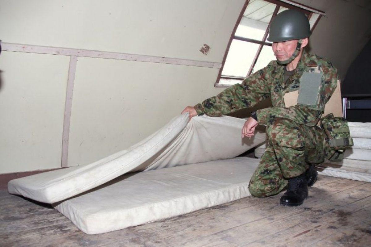 Ahí se escondió entre dos colchonetas, con lo que no pasó frío Foto:AFP