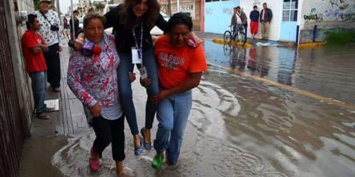 Despiden a #LadyReportera de TV Azteca por no querer mojarse y memes la destrozan