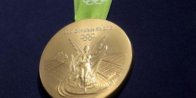 n la otra cara de la medalla está la imagen de la diosa Nike y el estadio Panathinaiko con la Acrópolis de fondo L Foto:Getty Images