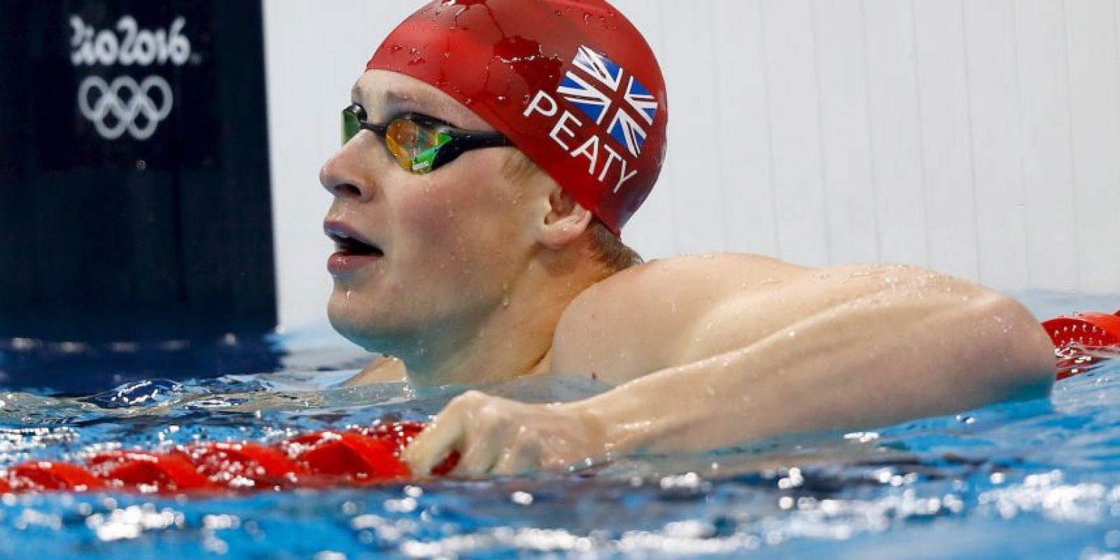 Adam Peaty. El británico detuvo el reloj en 100 metros braza en 3:56.46 Foto:Getty Images