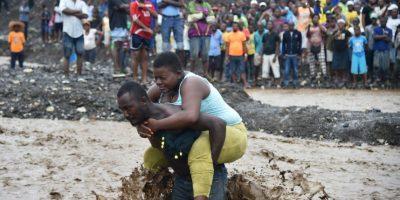 """AFP Foto:Las postales que """"Matthew ha dejado en su paso por América"""" Puerto Príncipe, Haiti, 5 de octubre."""