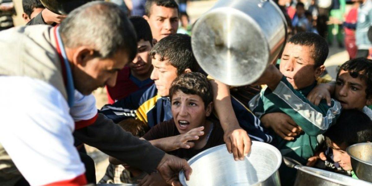 Los habitantes de Mosul esquivan bombas, disparos y el acoso del EI