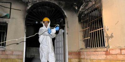 Un forense examina el dormitorio de la residencia de estudiantes incendiada en Adana, Turquía, el 30 de noviembre de 2016 Foto:-/afp.com