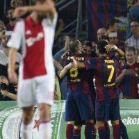 21 octubre 2014: El Barça recuperó el tranco ganador con una contundente victoria 3-1 sobre Ajax en el Camp Nou: Con goles de Neymar, Messi y Sandro Ramírez, los catalanes sumaron de a tres Foto:AFP
