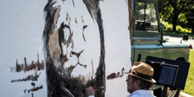 Pinturas en memoria al león Foto:AFP