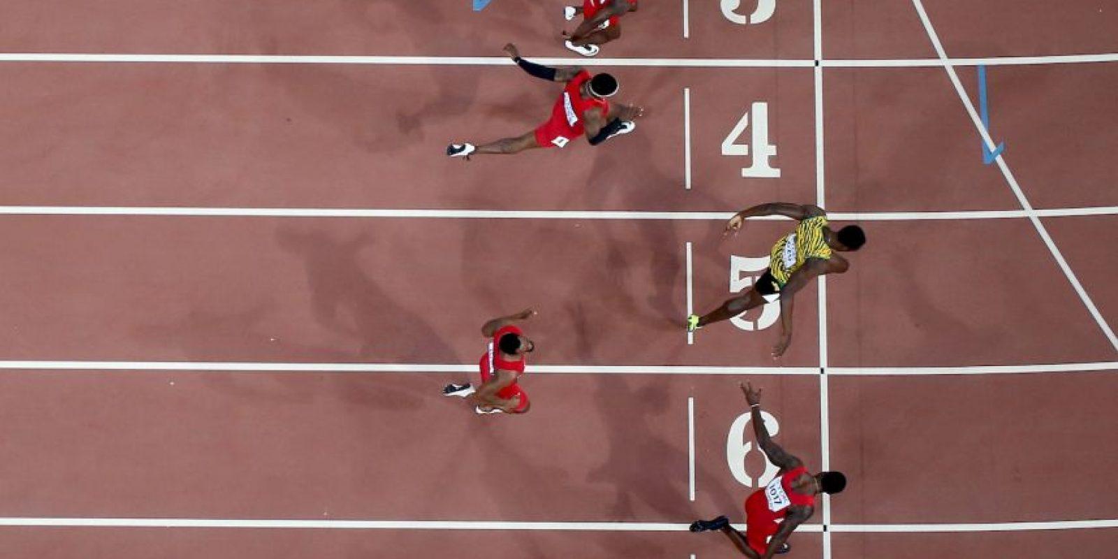 El velocista jamaiquino derrotó a Justin Gatlin en la final de los 100 metros planos del Mundial de Atletismo en Pekín, China. Foto:Getty Images